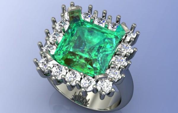 Smeraldo contornato di diamanti in oro bianco 18kt.