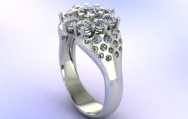 Anello con diamanti a cestino in oro bianco 18kt.